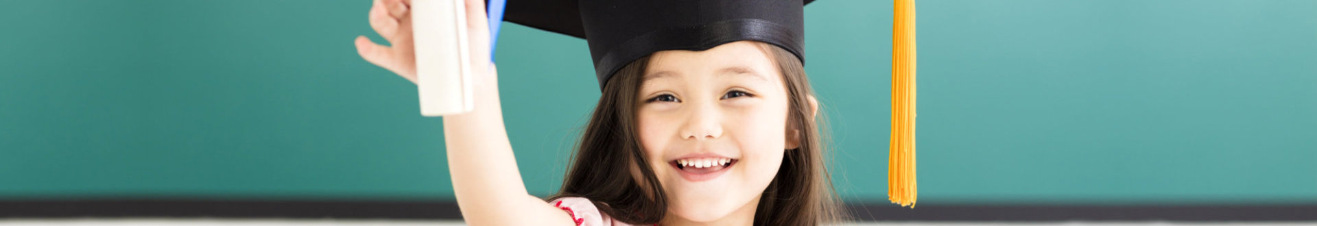 little girl wearing a graduation cap