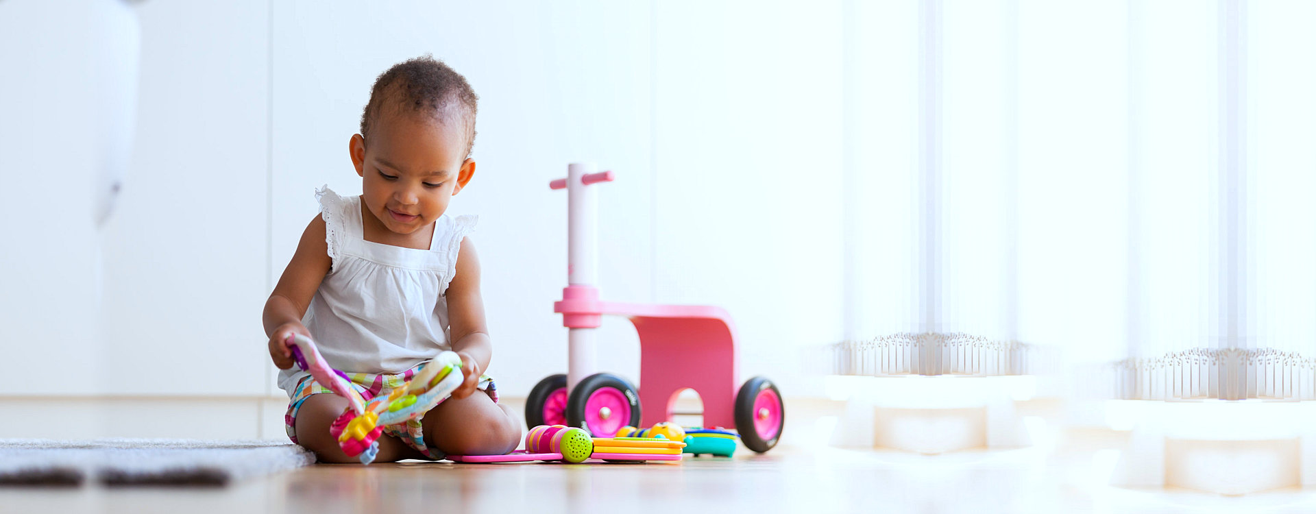 little girl playing with her toys