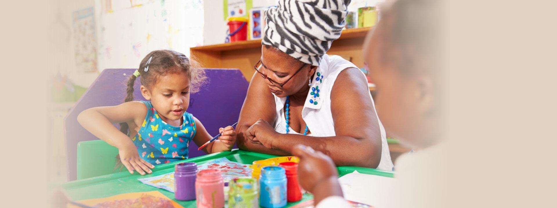 lady teaching little girl